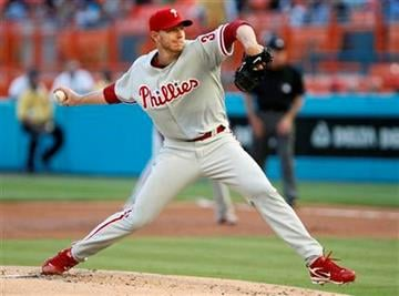 Philadelphia Phillies' Roy Halladay delivers a pitch during the first inning of a baseball game against the Florida Marlins, Saturday, May 29, 2010, in Miami. (AP Photo/Wilfredo Lee) By Wilfredo Lee