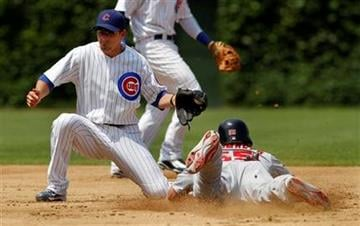 St. Louis Cardinals' Skip Schumaker steals second in the third inning as Chicago Cubs second baseman Ryan Theriot takes a late throw during a baseball game Sunday, May 30, 2010, in Chicago. (AP Photo/John Smierciak) By John Smierciak
