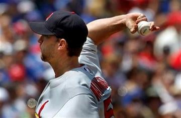 St. Louis Cardinals starting pitcher Adam Wainwright throws during the first inning against the Chicago Cubs in a baseball game Sunday, May 30, 2010, in Chicago. (AP Photo/John Smierciak) By John Smierciak