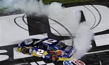 Kurt Busch does a burnout after winning the NASCAR Sprint Cup Series' Coca-Cola 600 auto race at Charlotte Motor Speedway in Concord, N.C., Sunday, May 30, 2010. (AP Photo/Gerry Broome) By Gerry Broome