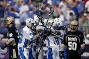 Duke players celebrate their 6-5 overtime win over Notre Dame in the NCAA men's lacrosse tournament championship game Monday, May 31, 2010, in Baltimore. (AP Photo/Rob Carr)