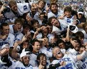 Members of the Duke team celebrate after defeating Notre Dame 6-5 in overtime to win the NCAA men's lacrosse tournament championship game Monday, May 31, 2010, in Baltimore. (AP Photo/Rob Carr)