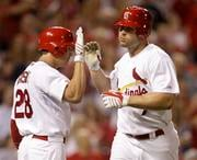 St. Louis Cardinals' Matt Holliday, right, is congratulated by Colby Rasmus after hitting a solo home run during the seventh inning of a baseball game against the Cincinnati Reds on Wednesday, June 2, 2010, in St. Louis. (AP Photo/Jeff Roberson)