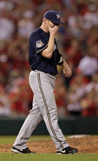 Milwaukee Brewers starting pitcher Randy Wolf reacts to giving up a two-run home run to St. Louis Cardinals' Colby Rasmus in the sixth inning of a baseball game, Friday, June 4, 2010, in St. Louis.(AP Photo/Tom Gannam) By Tom Gannam