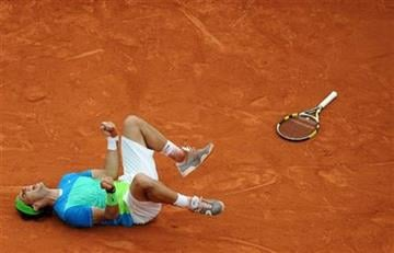Spain's Rafael Nadal jubilates after defeating Sweden's Robin Soderling during a men's finals match for the French Open tennis tournament at the Roland Garros stadium in Paris, Sunday, June 6, 2010. (AP Photo/Laurent Baheux) By Laurent Baheux