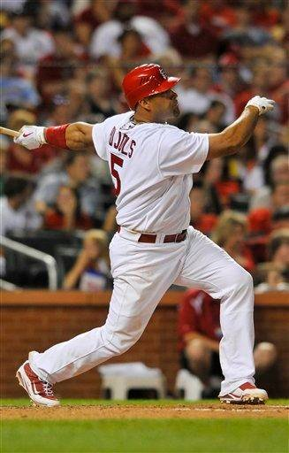 St. Louis Cardinals' Albert Pujols follows through on a solo home run off of Milwaukee Brewers starting pitcher Manny Parra during the sixth inning of a baseball game Sunday, June 6, 2010, in St. Louis. (AP Photo/Jeff Curry) By Jeff Curry