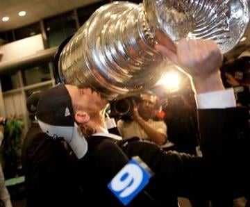 The Chicago Blackhawks Patrick Kane kisses the Stanley Cup in the terminal as O'Hare airport in Chicago  Thursday June 10, 2010.(AP Photo/Charles Cherney) By Charles Cherney