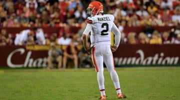 LANDOVER, MD - AUGUST 18:  Qarterback Johnny Manziel #2 of the Cleveland Browns looks on during a preseason game against the Washington Redskins at FedExField on August 18, 2014 in Landover, Maryland.  (Photo by Rob Carr/Getty Images) By Rob Carr