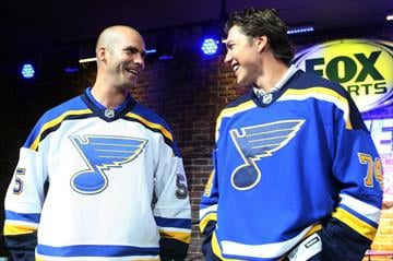 St. Louis players Barrett Jackman (L) and T.J. Oshie laugh as they show off the new home (R) and away jerseys, during a rally in St. Louis on August 25, 2014.    UPI/Bill Greenblatt By BILL GREENBLATT