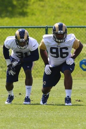 EARTH CITY, MO - MAY 16: Michael Sam #96 and Maurice Alexander #31 of the St. Louis Rams participate in a rookie minicamp at Rams Park on May 16, 2014 in Earth City, Missouri.  (Photo by Dilip Vishwanat/Getty Images) By Dilip Vishwanat