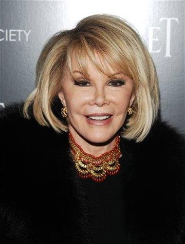 """FILE - In this Dec. 13, 2010 file photo, comedian Joan Rivers attends a Cinema Society screening of """"Blue Valentine"""" in New York. (AP Photo/Peter Kramer, file) By Peter Kramer"""
