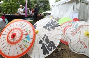 Large paper parisol umbrella's are on display for sale during the Japanese Festival in St. Louis on September 2, 2012. The annual event held over Labor Day weekend features Japanese food, music and culture.   UPI/Bill Greenblatt By BILL GREENBLATT