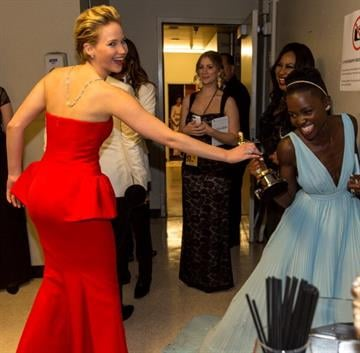 HOLLYWOOD, CA - MARCH 02:  Actresses Jennifer Lawrence (L) and Lupita Nyong'o backstage during the Oscars held at Dolby Theatre on March 2, 2014 in Hollywood, California.  (Photo by Christopher Polk/Getty Images) By Christopher Polk