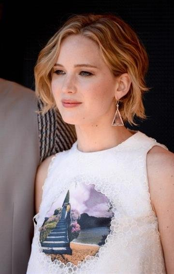 """CANNES, FRANCE - MAY 17:  Actress Jennifer Lawrence attends """"The Hunger Games: Mockingjay Part 1"""" photocall at the 67th Annual Cannes Film Festival on May 17, 2014 in Cannes, France.  (Photo by Ian Gavan/Getty Images) By Ian Gavan"""