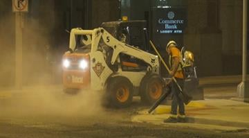 City street crews began working to fix and patch rough spots Tuesday night after the traffic from the Cardinals game cleared. By Stephanie Baumer