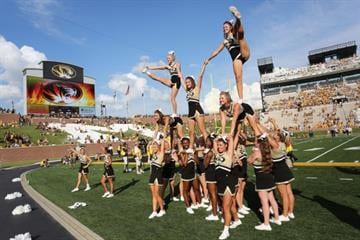 COLUMBIA , MO - AUGUST 30: Missouri Tigers cheerleaders perform during a game against the South Dakota State Jackrabbits in the fourth quarter at Memorial Stadium on August 30, 2014 in Columbia, Missouri.  (Photo by Ed Zurga/Getty Images) By Ed Zurga