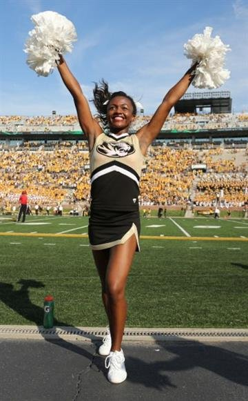 COLUMBIA , MO - AUGUST 30:  A Missouri Tigers cheerleader performs during a game against the South Dakota State Jackrabbits in the fourth quarter at Memorial Stadium on August 30, 2014 in Columbia, Missouri.  (Photo by Ed Zurga/Getty Images) By Ed Zurga