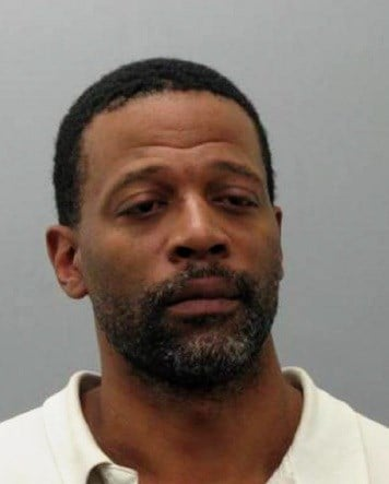 Christopher Booker, 41, of St. Louis is accused of sealing cash, cell phones, iPads, iPad minis, and other electronic devices from an AT&T store in Wood River, Illinois. By Stephanie Baumer