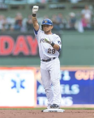 MILWAUKEE, WI - SEPTEMBER 6: Gerardo Parra #28 of the Milwaukee Brewers raises his fist after hitting a double against the St. Louis Cardinals at Miller Park on September 6, 2014 in Milwaukee, Wisconsin.  (Photo by Tom Lynn/Getty Images) By Tom Lynn