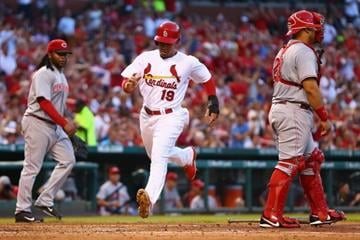 ST. LOUIS, MO - AUGUST 20: Jon Jay #19 of the St. Louis Cardinals scores a run against the Cincinnati Reds in the third inning at Busch Stadium on August 20, 2014 in St. Louis, Missouri.  (Photo by Dilip Vishwanat/Getty Images) By Dilip Vishwanat