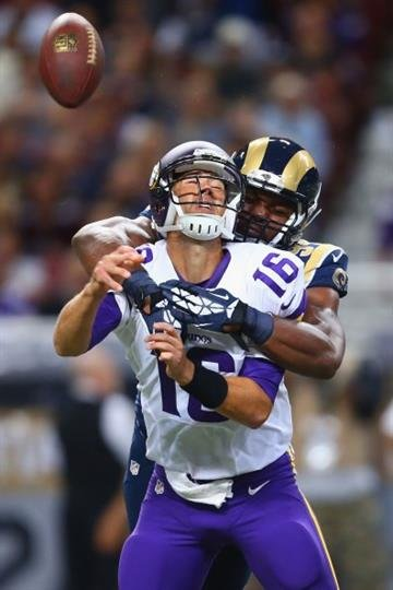 ST. LOUIS, MO - SEPTEMBER 7: Robert Quinn #94 of the St. Louis Rams sacks Matt Cassel #16 of the Minnesota Vikings at the Edward Jones Dome on September 7, 2014 in St. Louis, Missouri.  (Photo by Dilip Vishwanat/Getty Images) By Dilip Vishwanat