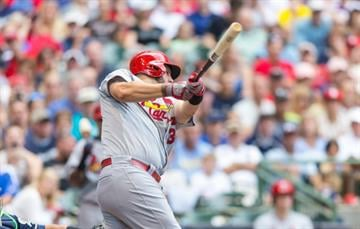 MILWAUKEE, WI - SEPTEMBER 7: Matt Adams #32 of the St. Louis Cardinals hits a sacrifice fly against the Milwaukee Brewers at Miller Park on September 7, 2014 in Milwaukee, Wisconsin.  (Photo by Tom Lynn/Getty Images) By Tom Lynn