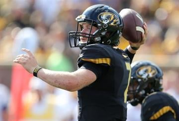 COLUMBIA , MO - AUGUST 30:  Quarterback Maty Mauk #7 of the Missouri Tigers passes against the South Dakota State Jackrabbits in the third quarter at Memorial Stadium on August 30, 2014 in Columbia, Missouri.  (Photo by Ed Zurga/Getty Images) By Ed Zurga
