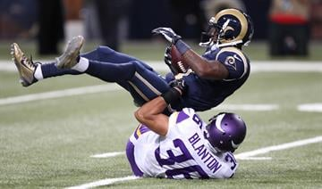 Minnesota Vikings Robert Blanton drags down St. Louis Rams Tavon Austin in the fourth quarter at the Edward Jones Dome in St. Louis on September 7, 2014.Minnesota won the game 34- 6.   UPI/Bill Greenblatt By BILL GREENBLATT