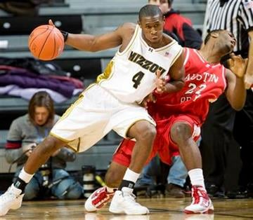 Missouri's J.T. Tiller, left, fouls Austin Peay's Wesley Channels as he drives toward the basket during the first half of an NCAA college basketball game Sunday, Dec. 27, 2009, in Columbia, Mo. (AP Photo/L.G. Patterson) By L.G. Patterson