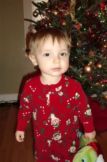Jude in his Christmas jammies in front of our tree By Afton Spriggs