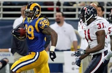 St. Louis Rams running back Steven Jackson (39) runs for a 35-yard gain as Houston Texans safety Bernard Pollard gives chase during the second quarter of an NFL football game Sunday, Dec. 20, 2009, in St. Louis. (AP Photo/Tom Gannam) By Tom Gannam