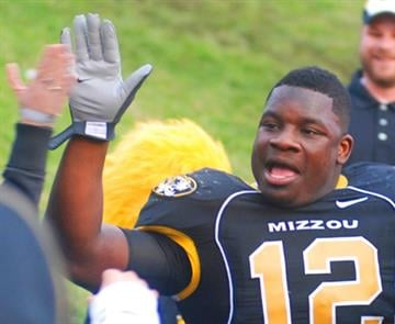 Missouri linebacker Sean Weatherspoon high-fives a fan in the stands after the Tigers won a game against Iowa State in Columbia, Mo., on Saturday, Nov. 21, 2009. (Photo credit: Nathan Giannini for KMOV) By Nathan Giannini