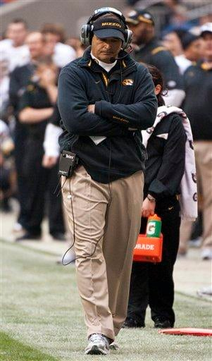 Missouri head coach Gary Pinkel walks the sidelines during the second quarter of the Texas Bowl NCAA college football game against Navy, Thursday, Dec. 31, 2009, in Houston. Navy defeated Missouri 35-13. (AP Photo/Dave Einsel) By Dave Einsel