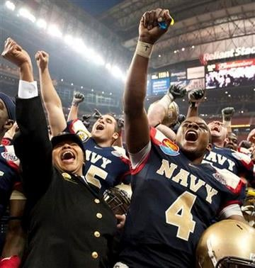 Navy quarterback Ricky Dobbs (4) celebrates with Vonn Banks, left, following the Texas Bowl NCAA college football game against Missouri, Thursday, Dec. 31, 2009, in Houston. Navy defeated Missouri 35-13. (AP Photo/Dave Einsel) By Dave Einsel