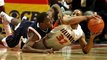 Gonzaga's Demetri Goodson and Illinois's Demetri McCamey scramble for the ball during the first half of an NCAA college basketball game on Saturday, Jan. 2, 2010, in Chicago. (AP Photo/Jim Prisching) By Jim Prisching