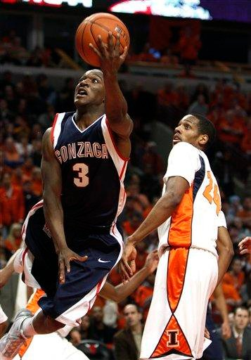 Gonzaga's Demetri Goodson, left, drives to the basket around Illinois's Mike Davis during the first half of an NCAA college basketball game Saturday, Jan. 2, 2010, in Chicago. (AP Photo/Jim Prisching) By Jim Prisching