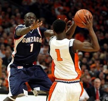 Gonzaga's Mangisto Arop defends against Illinois's D.J. Richardson during the first half of an NCAA college basketball game on Saturday, Jan. 2, 2010, in Chicago. (AP Photo/Jim Prisching) By Jim Prisching