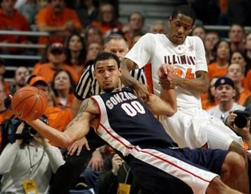 Gonzaga's Robert Sacre (00) and Illinois' Mike Davis fight for the ball during the second half of an NCAA college basketball game Saturday, Jan. 2, 2010, in Chicago. Gonzaga defeated Illinois 85-83 in overtime. (AP Photo/Jim Prisching) By Jim Prisching