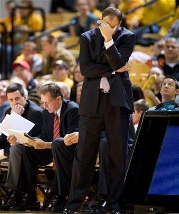 Georgia head coach Mark Fox covers his eyes toward the end of the second half during an NCAA college basketball game against Missouri Saturday, Jan. 2, 2010, in Columbia, Mo. Missouri won the game 89-61. (AP Photo/L.G. Patterson) By L.G. Patterson