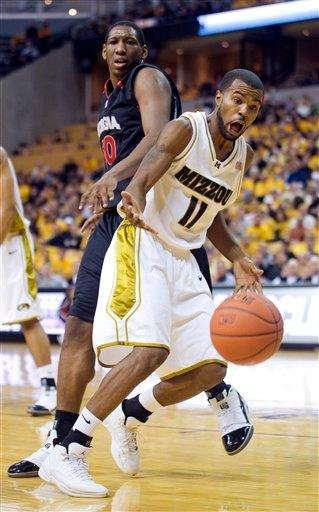 Missouri's Zaire Taylor, right, fouls Georgia's Jeremy Price during the first half their NCAA college basketball game Saturday, Jan. 2, 2010, in Columbia, Mo. (AP Photo/L.G. Patterson) By L.G. Patterson