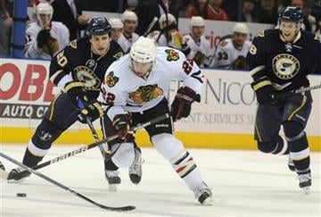 Chicago Blackhawks' Troy Brouwer (22) skates by St. Louis Blues' Alexander Steen (20) and Jay McClement, right, in the first period of an NHL hockey game Saturday, Jan. 2,  2010, in St. Louis. (AP Photo/Bill Boyce) By Bill Boyce