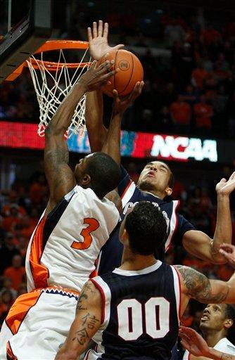 Illinois' Brandon Paul gets his shot blocked by Gonzaga's Elias Harris during the second half of an NCAA college basketball game Saturday, Jan. 2, 2010, in Chicago. Gonzaga defeated Illinois 85-83 in overtime. (AP Photo/Jim Prisching) By Jim Prisching