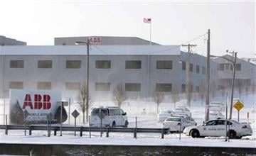 Police cars are seen at the scene of a shooting where a gunman with an assault rifle walked into the ABB Power Plant Thursday, Jan. 7, 2010, in St. Louis. (AP Photo/Jeff Roberson) By Jeff Roberson
