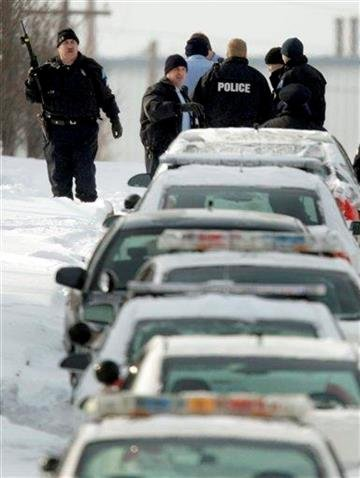 Police work at the scene of a shooting after a gunman with an assault rifle walked into the ABB Power plant and began shooting Thursday, Jan. 7, 2010, in St. Louis. (AP Photo/Jeff Roberson) By Jeff Roberson