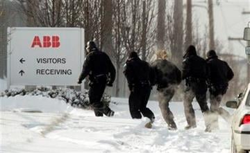 Police run into a building as they search for a gunman who walked into the ABB Power plant with an assault rifle and began shooting Thursday, Jan. 7, 2010, in St. Louis. (AP Photo/Jeff Roberson) By Jeff Roberson