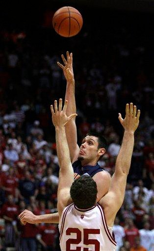 Illinois center Mike Tisdale, top, shots on over Indiana forward Tom Pritchard during the first half of an NCAA college basketball game in Bloomington, Ind., Saturday, Jan. 10, 2010. (AP Photo/Darron Cummings) By Darron Cummings
