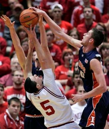 Indiana guard Jeremiah Rivers (5) has his shot blocked  by Illinois forward Bill Cole, right, during the first half of an NCAA college basketball game in Bloomington, Ind., Saturday, Jan. 10, 2010. (AP Photo/Darron Cummings) By Darron Cummings