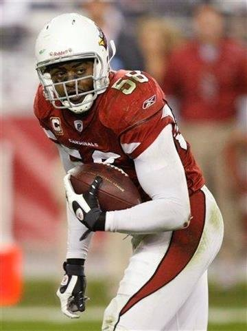 Arizona Cardinals' Karlos Dansby runs a fumble back for a touchdown during overtime of an NFL wild-card playoff football game against the Green Bay Packers on Sunday, Jan. 10, 2010, in Glendale, Ariz. Arizona won 51-45. (AP Photo/Matt York) By Matt York