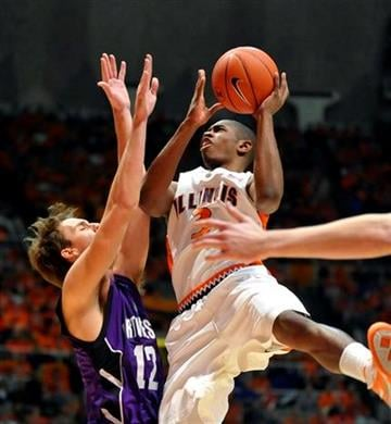Illinois' Brandon Paul (3) tries to shoot over Northwestern's Luka Mirkovic (12) during the first half of an NCAA college basketball game at Assembly Hall in Champaign, Ill.,on Wednesday, Dec. 30, 2009. (AP Photo/Heather Coit) By Heather Coit