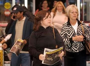 Amber Broiskie, center, shops early in the morning on Black Friday at Best Buy in Farmers Branch, Texas, on Friday, Nov. 27, 2009.. (AP Photo/Mike Fuentes) By Mike Fuentes